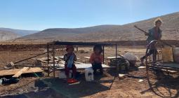 Children from Ras al Tin following the confiscation of their homes, water tanks and livelihood structures by Israeli forces, 14 July 2021. Photo by OCHA